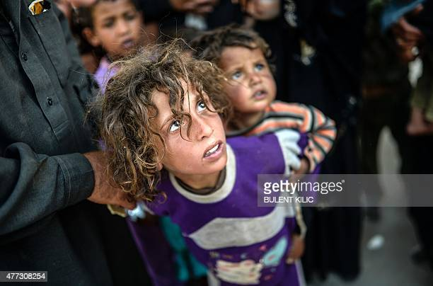 Syrians children arrive at the Akcakale crossing gate between Turkey and Syria at Akcakale in Sanliurfa province on June 16 2015 Turkey said it was...