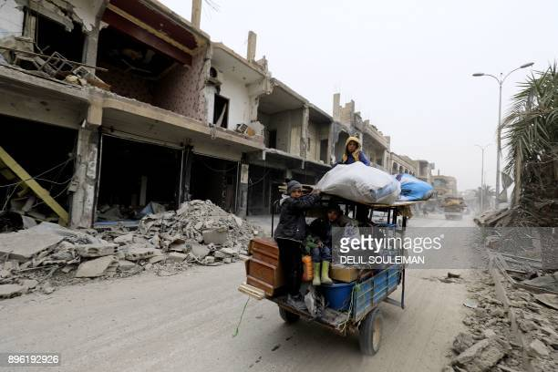 Syrians children return to Raqa on December 20 two months after YPG-led Syrian Democratic Forces captured the city from the Islamic State group. /...