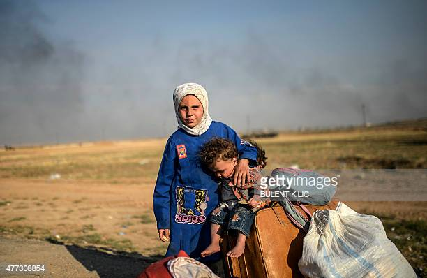 Syrians children wait after entering in Turkey at the Akcakale crossing gate between Turkey and Syria at Akcakale in Sanliurfa province on June 16...