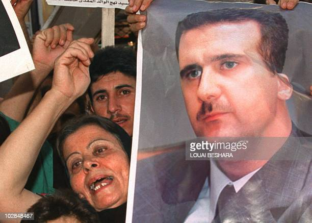 Syrians demonstrate in support of presidentdesignate Bashar alAssad outside the parliament building in Damascus 26 June 2000 as the 250member...