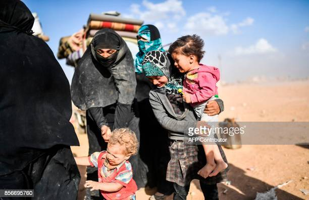 Syrians displaced from the city of Deir Ezzor gather on the outskirts of Raqa on October 2 2017 Syrian fighters backed by US special forces are...