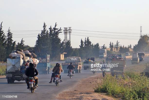 Syrians drive with their belongings along the main DamascusAleppo highway near the town of Saraqib in Syria's jihadistheld Idlib province on May 9...