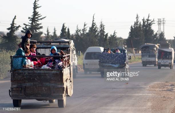 TOPSHOT Syrians drive with their belongings along the main DamascusAleppo highway near the town of Saraqib in Syria's jihadistheld Idlib province on...