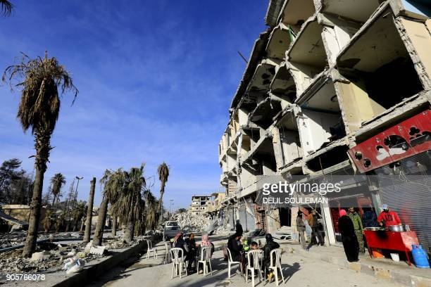 TOPSHOT Syrians eat falafel at the King's Restaurant the oldest and most famous falafel restaurant in the northern Syrian city of Raqa on January 9...