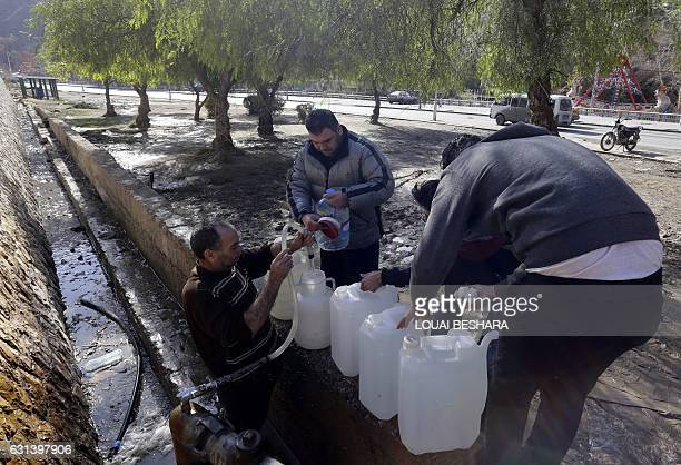 Syrians fill plastic containers with water in the capital Damascus on January 10 2017 Millions of people have been without water for weeks after...