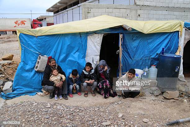 Syrians fled with their family of eight from attacks of Islamic State of Iraq and Levant from Syrian city of Hama is seen in front of 5 square meter...
