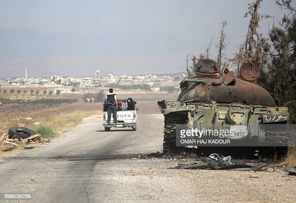 Syrians flee during clashes between fighters from the Jund alAqsa Islamist Brigade and Syrian government forces in the northern Syrian town of...