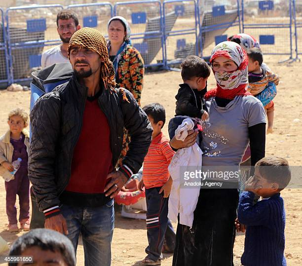 Syrians fleeing from clashes between Islamic State of Iraq and the Levant militants and Democratic Union Party forces in the Tal Abyad diistrict of...