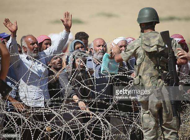 Syrians fleeing from clashes between the Islamic State of Iraq and Levant militants and Democratic Union Party forces in the Ar-Raqqah Governorate of...
