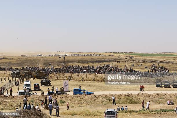 Syrians fleeing the clashes in Rasulayn region of Syria wait at the Syrian side of the TurkishSyrian borderline to cross into Turkey near Akcakale...