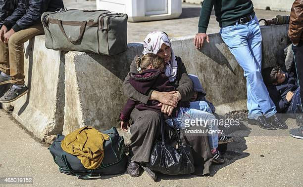 Syrians fleeing the Syrian civil war enter Turkey via Cilvegozu border crossing in Hatay's Reyhanl district on the TurkishSyrian border on March 3...