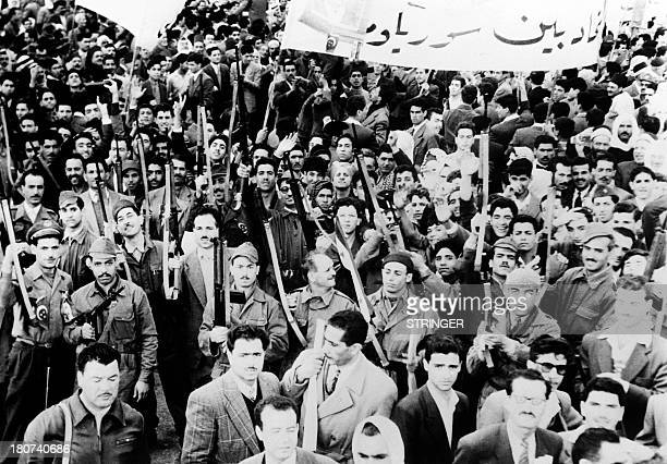 Syrians hold arms as they gather at the Damascus airport on November 20 1957 to welcome Egyptian members of Parliament arriving for a diplomatic...