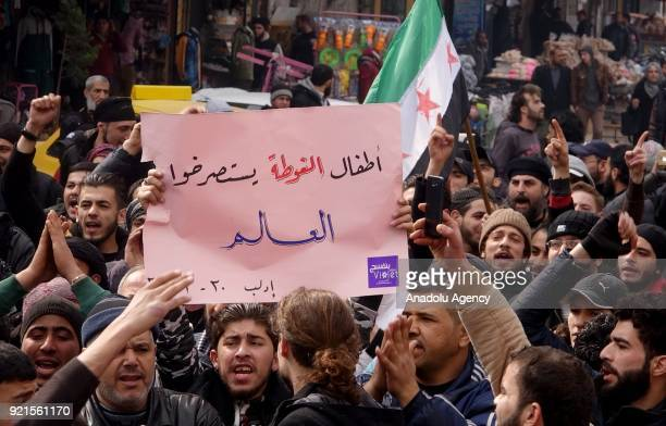 Syrians hold placards as they gather to protest against Assad Regime's blockade on Eastern Ghouta region of Damascus in Idlib Syria on February 20...