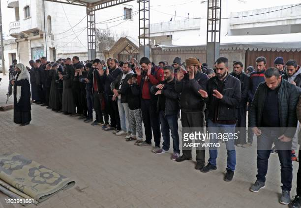 Syrians in Sarmada in the northwestern Idlib province on February 28 2020 perform funerary prayers for several dozen Turkish soldiers who were killed...