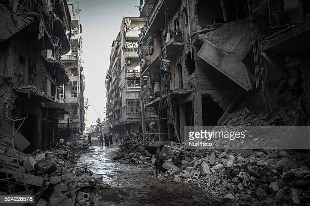 Syrians inspect rubble of a destroyed building following a reported air strike by Syrian government forces on March 7 2014 during the Friday prayers...