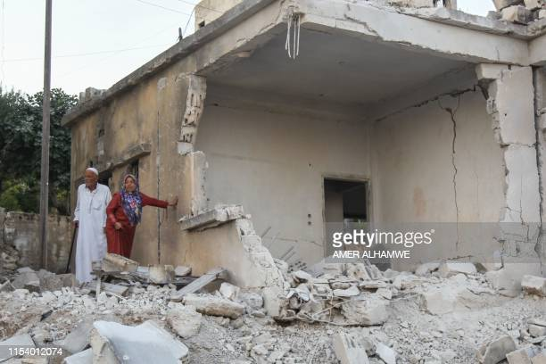Syrians inspect the damage following reported regime airstrikes on the town of Muhambal in the northern Idlib province on July 6 2019 Syrian regime...