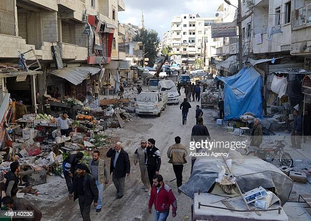 Syrians inspect the site of the Russian airstrikes targeting a market and residential area in Ariha town Idlib northern Syria on November 29 2015