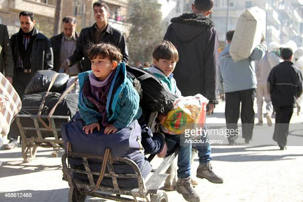Syrians leaving their home cities as the barrel bomb attacks of the regime forces in Aleppo threaten lives Syria February 11 2014