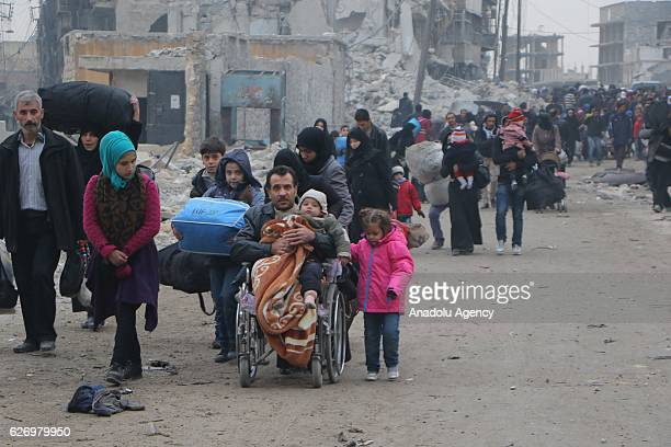 Syrians living in Aleppo flee the city due to ongoing regime forces attacks and move to opposition controlled areas on December 1 2016