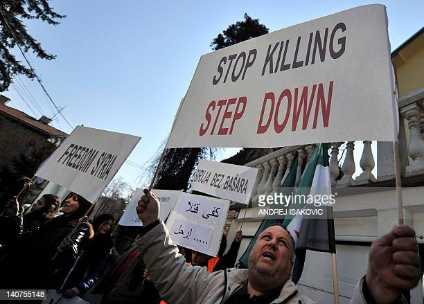 Syrians living in Serbia gather for a protest against the regime of Syrian president in front of the Syrian embassy in Belgrade on March 6, 2012....