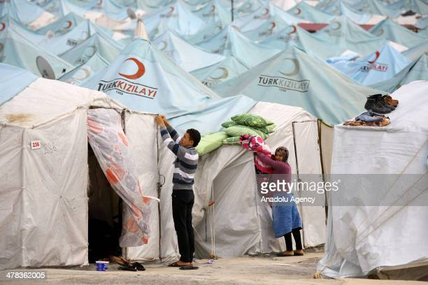 Syrians, migrate to Hatay due to civil war in Syria, on the streets of tent city in Hatay, Turkey on March 5, 2014. Children can't go out due to bad...