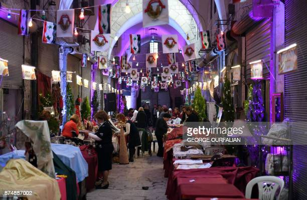 Syrians prepare merchandise for sale during a celebration in Aleppo's historic souk as it reopens on November 16 2017 Despite the government's...