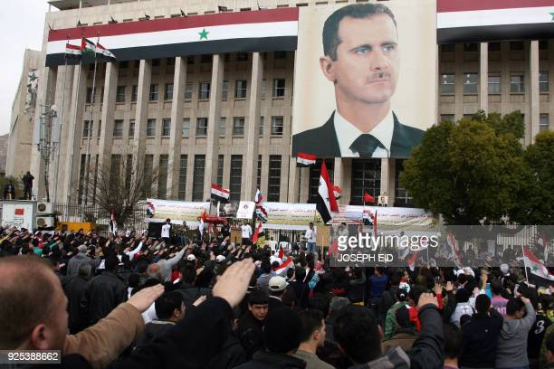 Syrians rally in support of President Bashar alAssad in central Damascus on February 15 2012 Syria's president decreed a vote on a new constitution...