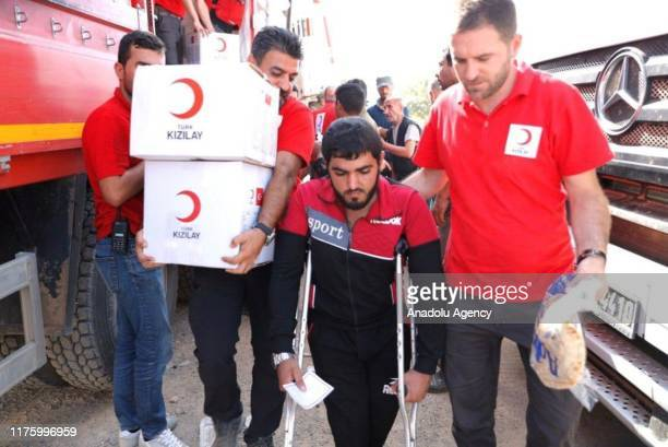 Syrians receive food aid from Turkish Red Crescent in Tal Abyad city center which was cleared from PKK and YPG within Turkey's Operation Peace Spring...