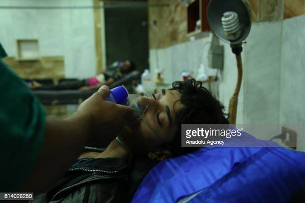 Syrians receive medical treatment after Assad regime's alleged chemical gas attack over oppositions' frontline where is included in deconfliction...