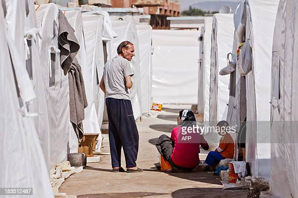 Syrians refugees are seen in a camp near the northern town of Azaz on the border with Turkey on October 5 2012 Damascus' bloody crackdown on the...