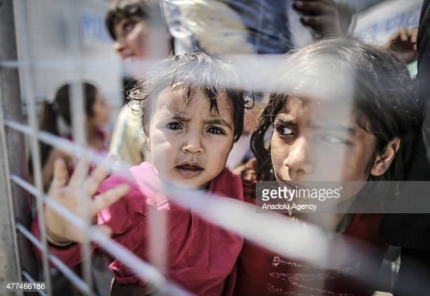 Syrians return to the Syrian town of Tal Abyad from Turkey near Akcakale border crossing in Sanliurfa province on June 17 2015 after Free Syrian Army...