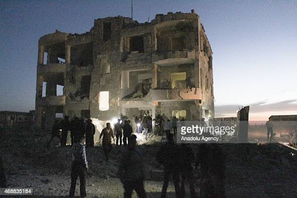Syrians run away after Daesh militans' suicide bomb attack around a quarter of Shamiyye Front in Aleppo's Azaz town, Syria, on April 7, 2015. At...