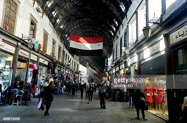 Syrians shop in the Hamidiyeh popular market in the old part of the capital Damascus on November 26 2015 AFP PHOTO / JOSEPH EID / AFP / JOSEPH EID