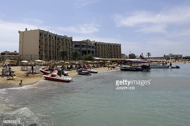 Syrians spend the day at the beach in Latakia northwest of Damascus on May 19 2014 A massive influx of displaced families mainly from Aleppo to...