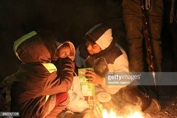 Syrians try to get warm as they wait to be evacuated from the east part of Aleppo that had been under siege by Assad Regime forces and its supporter...