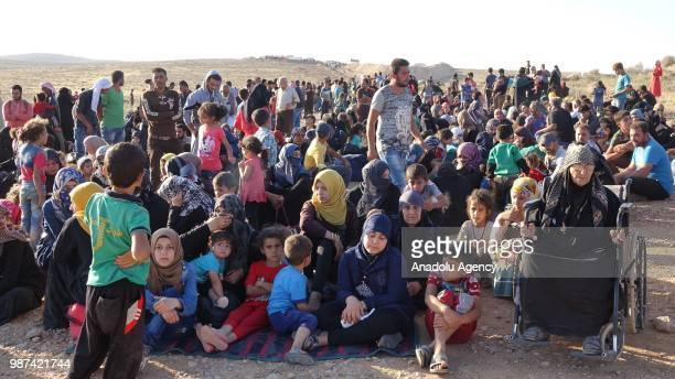 Syrians wait at the border areas near Jordan after they fled from the ongoing military operations by Bashar alAssad regime and its allies in Syrias...