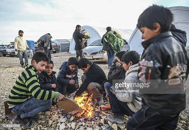 Syrians who fled bombing in Aleppo are seen at a tent city and close to the Bab alSalam border crossing on TurkishSyrian border near Azaz town of...