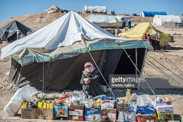 Syrians who fled their homes due to Civil war in Syria take shelter near Turkish border after the region was cleared as part of Turkeys Operation...
