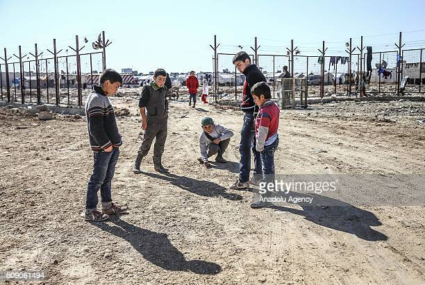Syrians who flee the attacks of Syrian and Russian air forces shelter at tents and try to live their lives with humanitarian aid send by Turkey at...
