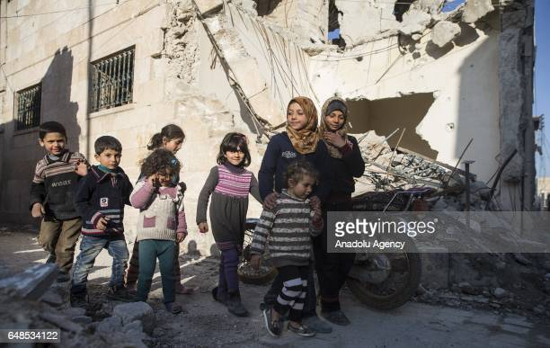 """Syrians who have returned to their home after the Al Bab town center has been entirely freed from Daesh terrorists as part of the """"Operation..."""