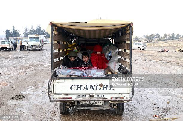 TOPSHOT Syrians who left the last rebelheld pockets of Syria's northen city of Aleppo arrive on December 22 2016 in the oppositioncontrolled Khan...