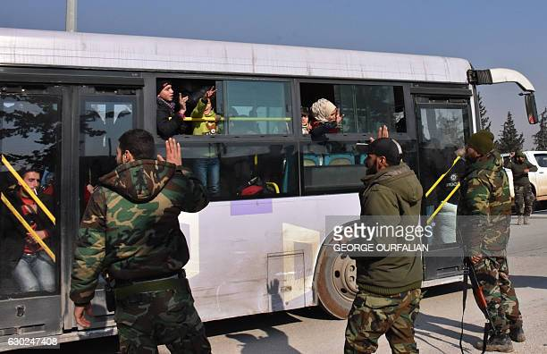 TOPSHOT Syrians who were evacuated from Fuaa and Kafrayatwo Shiite villages under rebelsiege on the northern outskirts of Idlib are welcomed by...