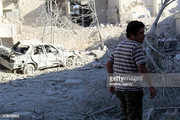 Syrians with search and rescue team inspect debris after Asad Regime Forces' barrel bomb attack on the residential areas in Bab alNairab neighborhood...