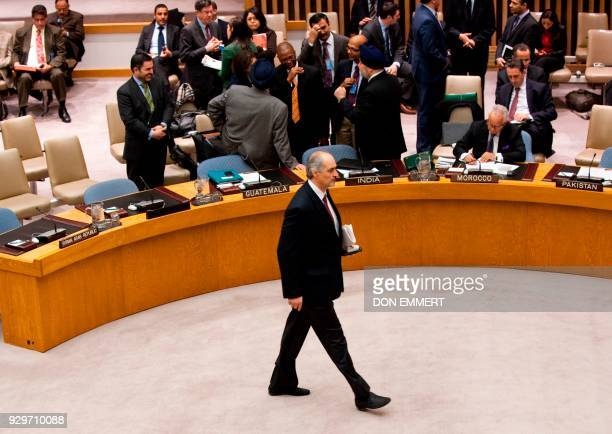 Syria's Ambassador to the UN Bashar alJa'fari on the floor before a vote on a resolution on Syria in the United Nations Security Council during a...