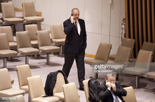 Syria's Ambassador to the UN Bashar alJa'fari talks on his cell phone before a vote on a resolution on Syria in the United Nations Security Council...