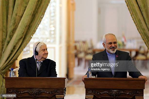 Syria's Foreign Minister Walid Muallem and his Iranian counterpart Mohammad Javad Zarif hold a joint press conference at Iran's Ministry of Foreign...