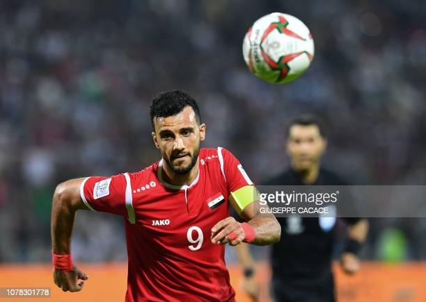 Syria's forward Omar Al Soma runs after the ball during the 2019 AFC Asian Cup Group B football game between Syria and Palestine at the Sharjah...