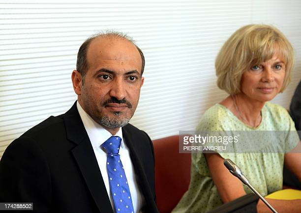 Syria's new opposition chief Ahmad Jarba is pictured next to Elisabeth Guigou head of the French national assembly Foreign Affairs commitee before...