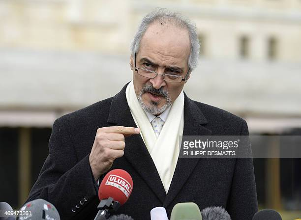 Syria's permanent representative at the United Nations Bashar alJaafari gestures during a press conference on the Syrian peace talks in front of the...