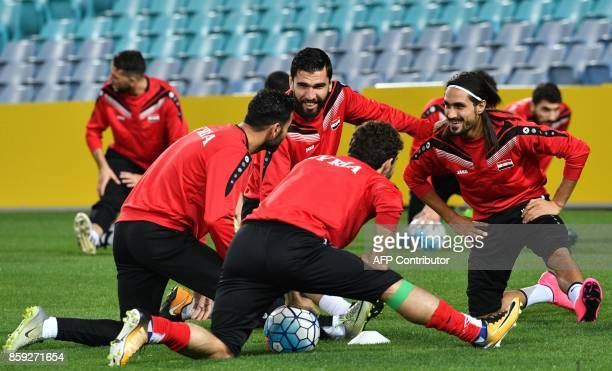 Syria's player Tamer Hag Mohd shares a light moment with teammates during a training session in Sydney on October 9 on the eve of their 2018 World...